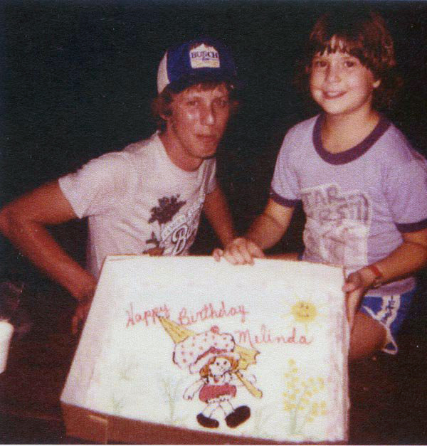 Me and my brother Roy, and my Strawberry Shortcake birthday cake on my 10th birthday in 1981. (also had on a Strawberry Shortcake wristwatch that you can barely see...and I still have it!).